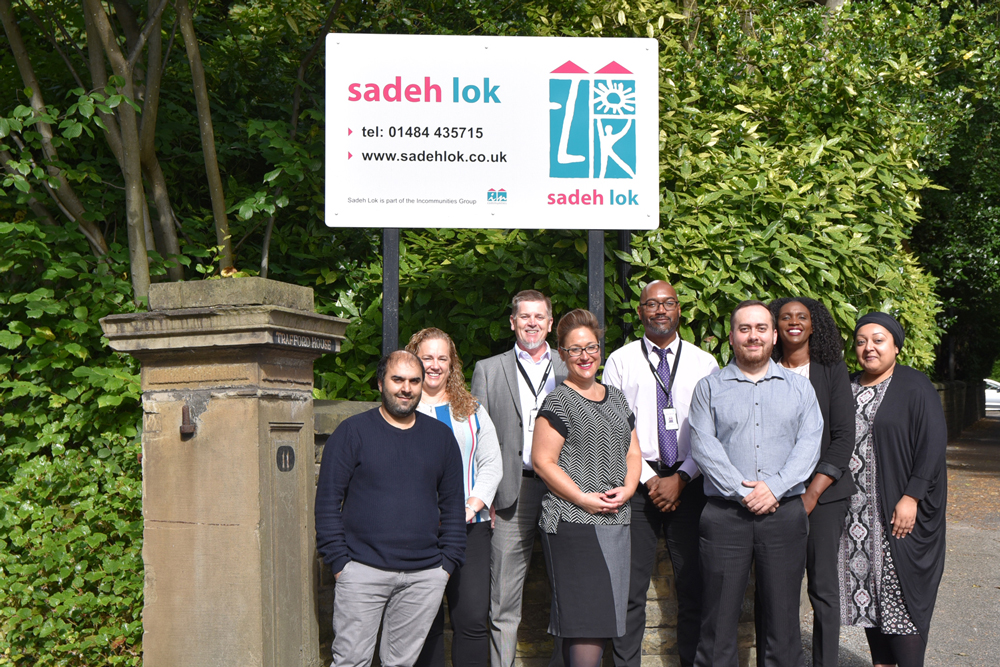 Sadeh Lok Staff outside their Huddersfield Office